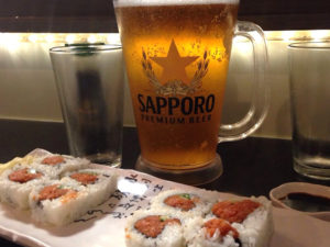 Sapporo Beer with Sushi Rolls